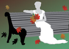 Bride and autumnal leaves Stock Image