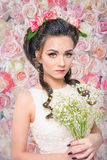 Bride with Baby's Breath bouquet on flower background Stock Photos