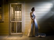 Bride on Back Porch Stock Images
