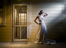Bride on Back Porch. Tall Young Bride Alone on Back Porch Stock Photo