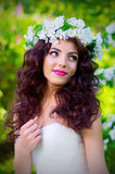 Bride on the background of blooming apple trees Stock Photo