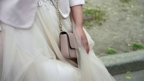 Bride with bag. Staying outdoors stock video footage