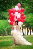 Bride with balloon Stock Images