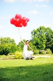 Bride  with balloons Stock Photos