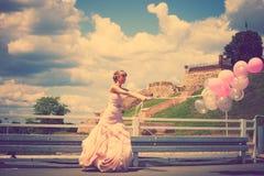 Bride with balloons Royalty Free Stock Photos