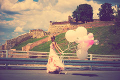 Bride with balloons Stock Photo