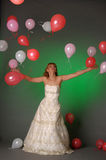 Bride and balloons i Royalty Free Stock Photo