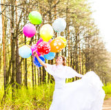Bride  with balloons  outdoor Stock Images