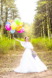 Bride  with balloons  outdoor Royalty Free Stock Photography