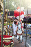 Bride with balloons rides on the carousel Royalty Free Stock Photos