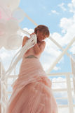 Bride with balloons Stock Image