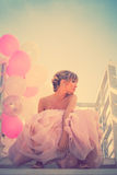 Bride with balloons Stock Images