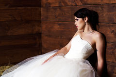 Bride in the barn. Bride with tattoo posing in the barn with hay Stock Photography