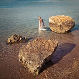 Bride is bathed in the sea Stock Images