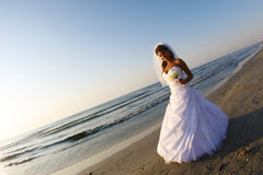 Bride on the beach. Bride alone on the beach Royalty Free Stock Images
