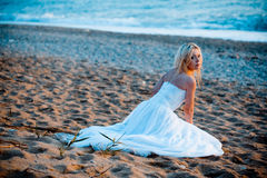 Bride at beach Royalty Free Stock Image