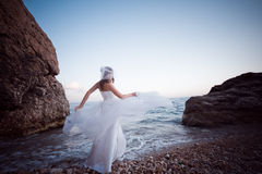 Bride on beach Stock Image