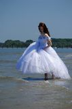 Bride on a beach Stock Image