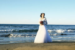 Bride on beach Royalty Free Stock Images