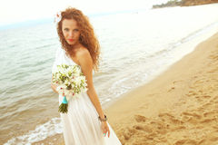 Bride on the beach Royalty Free Stock Photos