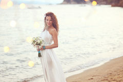 Bride on the beach Royalty Free Stock Image