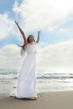 Bride on the Beach Expressing Her Joy Stock Photography