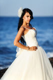 Bride on a beach in Santorini, GREECE. A shot with a brunette bride on a beach in Santorini Royalty Free Stock Images