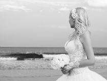 Bride on the beach. Unrecognizable young woman in  Royalty Free Stock Photo