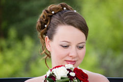 Bride with beautiful bouquet. Bride with bouquet of roses. Her wedding day Stock Photo