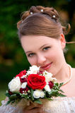 Bride with beautiful bouquet. Bride with bouquet of roses. Her wedding day Stock Photography