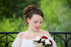 Bride with beautiful bouquet. Bride with bouquet of roses. Her wedding day Stock Photos