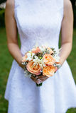 Bride with a beautiful bouquet of roses in her hands Stock Image