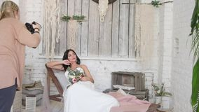 Bride is a beautiful brunette, lies on a couch in a beautiful interior in the style of a boho.  stock footage