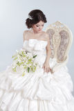Bride. Beautiful brunette woman wearing in modern wedding dress Royalty Free Stock Image