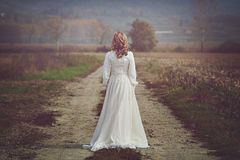 Bride with beautiful dress in country fields Royalty Free Stock Images