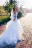 Bride in a beautiful dress and long veil Royalty Free Stock Photo