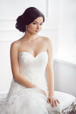Bride in beautiful dress sitting on chair indoors royalty free stock photos