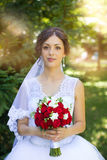 Bride with beautiful eyes at a wedding a walk in the woods. Portrait of the bride with big beautiful eyes Royalty Free Stock Images