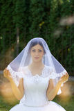 Bride with beautiful eyes at a wedding a walk in the woods. Portrait of the bride with big beautiful eyes Royalty Free Stock Photography