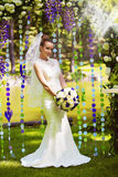 Bride in beautiful flower arch Royalty Free Stock Photos