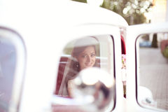Bride in a beautiful old car Stock Photo