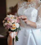 Bride with a beautiful pastel wedding bouquet Royalty Free Stock Photo
