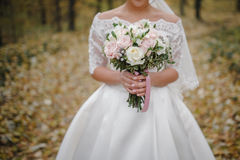 Bride with a beautiful pastel wedding bouquet Stock Photography