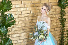 Bride in a beautiful turquoise dress in anticipation of wedding. Blonde in lace dress sea green with a bouquet . Happy bride Stock Images