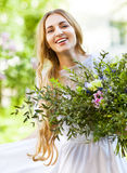 Bride with beautiful wedding bouquet of flowers in the style of Stock Photo