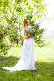 Bride with beautiful wedding bouquet of flowers in the style of Royalty Free Stock Photography