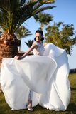 Bride in beautiful wedding long dress, young woman outdoor Royalty Free Stock Photos