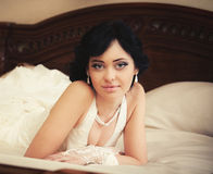 Bride on the bed Royalty Free Stock Photos