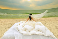 Bride in bed at the coastline. Royalty Free Stock Photography