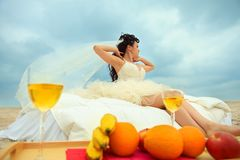 Bride in bed at the coastline Royalty Free Stock Photography